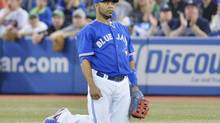 Toronto Blue Jays first baseman Edwin Encarnacion reacts after overthrowing the ball to first base for an error allowing Atlanta Braves DH Brian McCann to be safe at first during first inning interleague baseball action in Toronto on Tuesday, May 28, 2013. (Nathan Denette/THE CANADIAN PRESS)