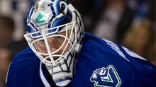 Vancouver Canucks goalie Jacob Markstrom, of Sweden, watches the play during first period NHL hockey action against the Colorado Avalanche in Vancouver, B.C., on Thursday April 10, 2014. (DARRYL DYCK/THE CANADIAN PRESS)