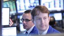 Traders work on the floor at the New York Stock Exchange, July 8, 2013. (BRENDAN MCDERMID/REUTERS)