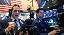 Traders work on the floor of the New York Stock Exchange (NYSE), April 7. (Drew Angerer/Getty Images)