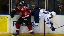 Abbotsford Heat's J.P. Testwuide upends the Toronto Marlies' Nazem Kadri during American Hockey League playoff action at Ricoh Coliseum in Toronto on May 3/2012. (Kevin Van Paassen/The Globe and Mail/Kevin Van Paassen/The Globe and Mail)