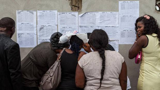 Volunteers check their ballot station locations in the Bayelsa state capital of Yenagoa on the eve of Saturday's election. (FLORIAN PLAUCHEUR/AFP/Getty Images)