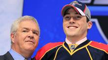 Florida Panthers' General Manager Dale Tallon (L) is seen with Erik Gudbranson during the first round of the 2010 NHL hockey draft in Los Angeles, California June 25, 2010.REUTERS/Mike Blake (MIKE BLAKE)