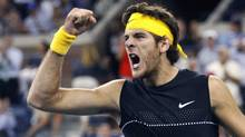 Juan Martin del Potro of Argentina celebrates winning the fourth set against Roger Federer of Switzerland during the men's final at the U.S. Open in New York on Monday. (KEVIN LAMARQUE)