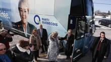 Parti Quebecois leader Pauline Marois greets candidate Gyslaine Desrosiers during a campaign stop in Blainville, Que., March 7, 2014. (CHRISTINNE MUSCHI/REUTERS)