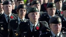 Members of the Canadian Forces wear poppies as they march during Remembrance Day ceremonies at the National War Memorial in Ottawa on Nov. 11, 2010. (Pawel Dwulit/THE CANADIAN PRESS)