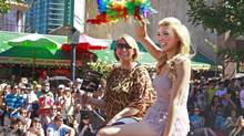 Miss Universe Canada contestant and transgender beauty queen Jenna Talackova waves to onlookers during the 35th Annual Gay Pride Parade in Vancouver, Aug. 5, 2012. (Jeff Vinnick/The Globe and Mail)