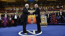 The 2015 Nobel physics laureate professor Arthur B. McDonald (L) of Canada receives his award from King Carl Gustaf of Sweden during the 2015 Nobel prize award ceremony, December 10, 2015. (JONAS EKSTROMER/AFP/Getty Images)