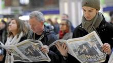 Commuters read copies of the Evening Standard newspaper, featuring a front page headline about the engagement of Britain's Prince William to Kate Middleton, at Victoria rail station in London, November 16, 2010. Britain's Prince William is to marry his long-term girlfriend Kate Middleton next year, after an on-off courtship lasting nearly a decade, bringing months of speculation about his intentions to an end. (Paul Hackett/Reuters/Paul Hackett/Reuters)