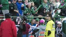 The crowd taunts Montreal Alouettes linebacker Shea Emry as he is escorted off the field after being given a game misconduct during the first half of CFL action against the Saskatchewan Roughriders in Regina, Sask., Saturday, October 20, 2012. (Liam Richards/THE CANADIAN PRESS)