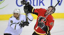 The Calgary Flames' Alex Tanguay gets hit with the high stick of the Dallas Stars' Trevor Daley in Calgary. (Todd Korol/Reuters/Todd Korol/Reuters)