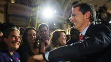 Liberal leader Dalton McGuinty shakes hands with supporters as he leaves election night headquarters in Ottawa, Thursday October 6, 2011. (Sean Kilpatrick/Sean Kilpatrick/The Canadian Press)