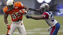 BC Lions slotback Shawn Gore (L) is stopped by Montreal Alouettes defensive back Jerald Brown during the first half of their CFL football game in Vancouver, British Columbia September 8, 2012. Brown agreed to a two-year contract with the Alouettes on Monday. (ANDY CLARK/REUTERS)