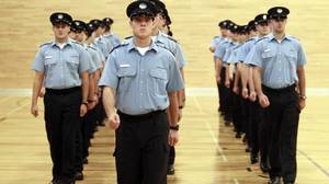 Recruits practice drills at the Ecole nationale de police du Quebec in Nicolet, Que.