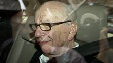 News Corp. chairman Rupert Murdoch arrives at his residence in London on Wednesday. (Sang Tan/AP)