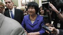 Canada's International Cooperation Minister Bev Oda (C) is escorted past journalists after testifying before the Commons Procedure and House Affairs committee on Parliament Hill in Ottawa March 18, 2011. (CHRIS WATTIE/REUTERS/CHRIS WATTIE/REUTERS)