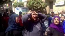 This image made from video shows relatives reacting after an Egyptian court on Monday sentenced to death 529 supporters of ousted Islamist President Mohammed Morsi in connection to an attack on a police station that killed a senior police officer in Minya, Egypt, on March 24, 2014. (Uncredited/AP)