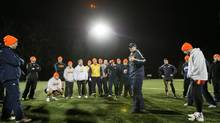 Queen¹s university rugby head coach Pete Huigenbos speaks to the team following a practice on Nixon field in Kingston, Ont., on Thursday Nov. 7, 2012. (Lars Hagberg/Lars Hagberg)