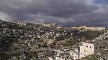 Jerusalem's Old City with the Dome of the Rock Mosque, right, is seen from the East Jerusalem neighborhood of Silwan. (DAN BALILTY/Associated Press)