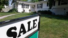 In this photo taken July 15, 2011, in Springfield, Ill., an existing home for sale, is shown. (Seth Perlman/AP)