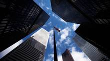Skyscrapers loom over a flagpole carrying the Canadian flag in the financial district in Toronto, March 11, 2009. (Mark Blinch/Reuters/Mark Blinch/Reuters)
