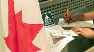 Filling out a Canadian visa application form.