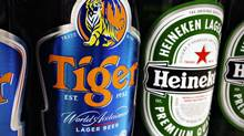 Bottles of Tiger and Heineken beers are pictured on the shelf of a grocery store in Singapore. (TIM CHONG/REUTERS)