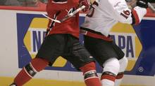 Team Canada's Blake Comeau collides with Team Switzerland's Raphael Diaz during first period action at the World Junior Hockey Championships in Vancouver, B.C. Wednesday Dec. 28, 2005. (RYAN REMIORZ/CP)