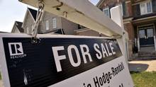 A for sale sign sits in front of a Mississauga residential home, April 16, 2012. (J.P. MOCZULSKI/J.P. MOCZULSKI for The Globe and Mail)