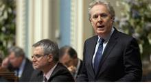 Quebec Premier Jean Charest responds to questions over the federal gun registry and the destruction of its information on Oct. 27, 2011, at the legislature in Quebec City. (Jacques Boissinot/THE CANADIAN PRESS/Jacques Boissinot/THE CANADIAN PRESS)