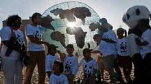 Members of the World Wide Fund converge on a beach in Durban, South Africa, during UN climate-change negotiations on Dec. 7, 2011. (RAJESH JANTILAL/AFP/Getty Images)