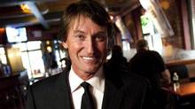 Wayne Gretzky poses in his restaurant in Toronto Thursday, September 9, 2010. Gretzky, the tousle-headed kid who turned the hockey world on its ear, turns 50 Wednesday. (Darren Calabrese)
