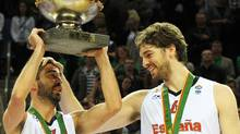 Spain's Juan Carlos Navarro (L) holds up the trophy next to teammate Pau Gasol as they celebrate their victory at the end of the EuroBasket 2011 final between Spain and France in Kaunas on September 18, 2011. Spain won 98-85. Getty Images/ JANEK SKARZYNSKI (JANEK SKARZYNSKI/Getty Images)