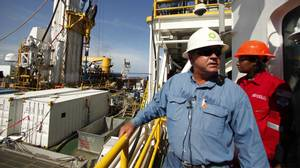Bobby Bolton, BP wellsite leader, talks to reporters on the Helix Q4000, which is performing the static kill procedure, at the site of the Deepwater Horizon Oil Spill in Gulf of Mexico, off the coast of Louisiana, Tuesday, Aug. 3, 2010.