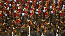 Indian soldiers march down Rajpath, a ceremonial boulevard, during a full dress rehearsal ahead of the Republic Day parade in New Delhi, India, Friday, Jan. 23, 2015. U.S President Barack Obama will be the chief guest during this year's parade which will be held on Jan. 26. (Saurabh Das/AP)