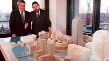 Paul Reichmann and Brian Mulroney look at a model of the proposed Canary Wharf in London. Mr. Reichmann has died at the age of 83. (RON POLING/THE CANADIAN PRESS)