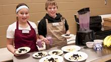 L'École Blanche-Bourgeois students prepare a local healthy snack for the other students in the school consisting of homemade crêpes, using organic whole-wheat flour, and topped with local blueberries and maple syrup. (Courtesy of Rachel Schofield)