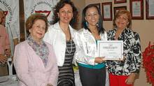 Elina Katsman, second from left, created the Smiles Foundation to provide dental care to children in need.