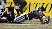 Toronto Argonauts' Pacino Horne scores a touchdown after intercepting a pass from the Calgary Stampeders in the second quarter during the 100th CFL Grey Cup championship football game in Toronto, November 25, 2012. (MIKE CASSESE/REUTERS)