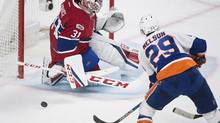 Montreal Canadiens goaltender Carey Price makes a save against New York Islanders' Brock Nelson on Feb. 23, 2017. (Graham Hughes/THE CANADIAN PRESS)