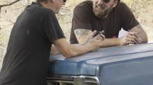 Director David Gordon Green, left, and Nicolas Cage, on the set of Joe. (Linda Kallerus/Roadside Attractions/Courtesy Everett Collection)