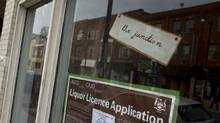 A front window at 3047 Dundas Street west displays it's application for a liquor license, on Dec. 11, 2012. (Peter Power/The Globe and Mail)