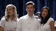 GLEE: Quinn (Dianna Agron, L) and Santana (Naya Rivera, R) console Kurt (Chris Colfer, C) (Adam Rose/FOX)