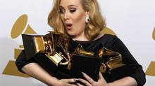 Singer Adele holds her six Grammy Awards at the 54th annual Grammy Awards in Los Angeles, California February 12, 2012. (LUCY NICHOLSON/REUTERS)