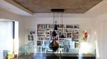 Interior photo showing bookshelf on upper floor in Byron Peart's condo at Habitat 67 in Montreal (Christinne Muschi/Christinne Muschi/The Globe and)