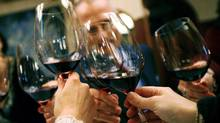 People raise their glasses in a toast at a luncheon for members of the wine press in New York October 30, 2007.