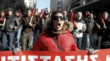 Anti-austerity protestors march in Athens last week. (YIORGOS KARAHALIS/REUTERS/YIORGOS KARAHALIS/REUTERS)