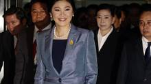 Thailand's Prime Minister Yingluck Shinawatra smiles as she arrives at the Constitutional Court in Bangkok May 6, 2014. (CHAIWAT SUBPRASOM/REUTERS)