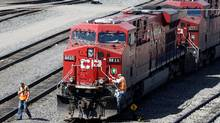 A crew works at CP's Calgary yard. Congestion at a grain terminal in Vancouver has cut into profit, one analyst says. (Todd Korol/REUTERS)