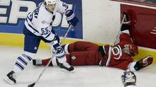 In this file photo, former Toronto Maple Leafs Drake Berehowsky is seen in action during a game at at the RBC Center in Raleigh, North Carolina February 19, 2004. (ELLEN OZIER/REUTERS)